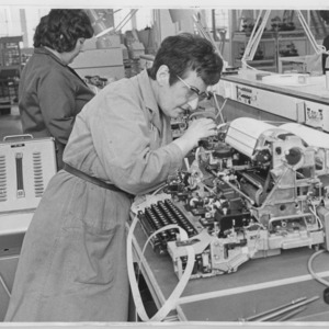 Miss Daisy Nolan servicing teleprinters in a Post Office factory
