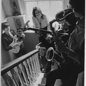 Young musicians in a stairwell