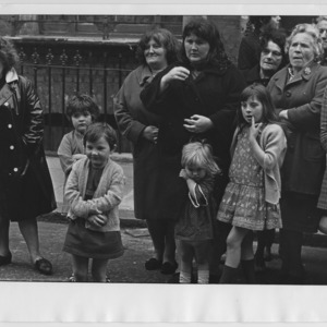 A crowd of women and children watching a street event in Islington